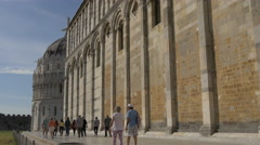Tourists walking towards the Battistero di San Giovanni in Pisa Stock Footage