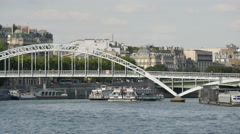 Boats floating under the Passerelle Debilly in Paris Stock Footage
