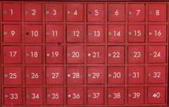 Stock Photo of deposit locker boxes in red color
