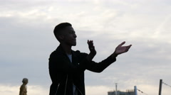 Man clapping his hands and moving on the rhythm at Trocadero esplanade, Paris Stock Footage