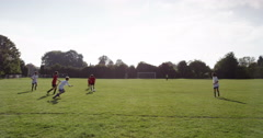 A young goal keeper stops a ball during a football match. Shot on RED Epic. Stock Footage