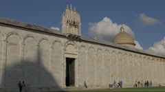 The beautiful Camposanto Monumentale with roof decorations and dome in Pisa - stock footage