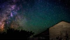 West Texas night sky with Milky Way and barn. Stock Footage