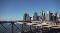 Brooklyn Bridge traffic and NYC skyline Stock Footage