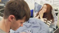 Stock Video Footage of Husband takes care of sick wife with fever in bed