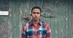 Slow Motion Portrait of mixed race man listening to music - stock footage