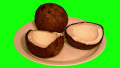 4k – One coconut and two halves on plate Stock Footage