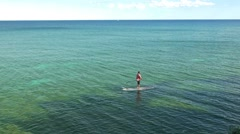 One man standing on paddle board Stock Footage