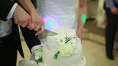 Hand cut the wedding cake brides Stock Footage