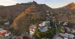 Stock Video Footage of Aerial flying backwards above luxury homes Hollywood Hills Los Angeles 4K UHD