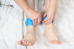 Male and female legs in handcuffs. couple. sex Toy Stock Photos
