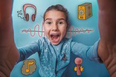 Girl smiles and takes the self happy joyful sound wave music rad Stock Photos