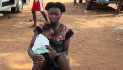 Stock Video Footage of Africa young mother with baby in market Buba