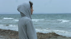 Lonely depressed woman looking at stormy sea, thinking of suicide. Broken heart Stock Footage