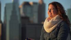 Woman looks at NYC skyline Stock Footage