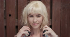Slow Motion Portrait of happy beautiful caucasian woman listening to music - stock footage