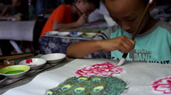Boy learning Chinese traditional painting Stock Footage