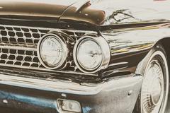 Headlight lamp of vintage classic car - stock photo