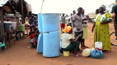 Stock Video Footage of Africa people talking in market city buba