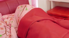 Woman sleeping in pink bed. Tossing and turning Stock Footage