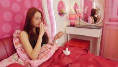 Ill woman lying in bed and using nasal spray Stock Footage