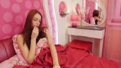 Ill woman taking pills in pink bedroom Stock Footage