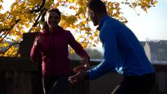 Trainer mobilize female jogger in the city park, slow motion, 240fps HD Stock Footage