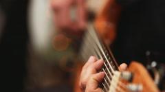 Musician playing bass guitar Stock Footage