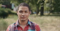 Slow Motion Portrait of happy mixed race man laughing - stock footage
