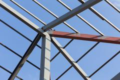Steel beams roof truss residential building construction industry Stock Photos