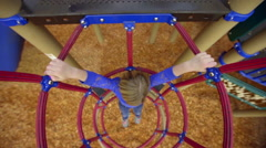Hanging from the jungle gym - stock footage