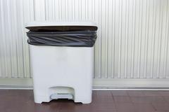 Black bag plastic in white trashcan bin Stock Photos