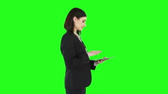 Business woman standing and using a tablet Stock Footage
