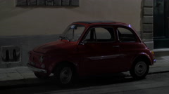 An old Fiat 500 on a street in Pisa Stock Footage
