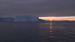 Icebergs at sunset from Disko Bay Stock Footage