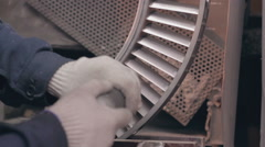Man polish detail of airplane engine Stock Footage