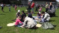 Parents with children build kite on park meadow. 4K Stock Footage