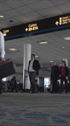 Busy crowd Dulles International Airport passenger terminal vertical HD Stock Footage