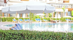 Swimming Pool. Hotel, Vacation, Waves, Umbrella, Tourism, Travel, Relax, Resort. Stock Footage