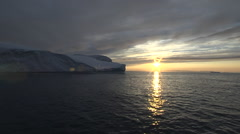 Icebergs at sunset from Disko Bay Greenland, in silhouette Stock Footage