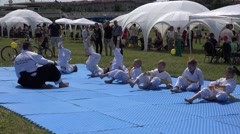 Stock Video Footage of children with coach make aikido art training outdoor. 4K