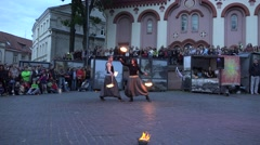 Amazing fire show with young artists couple juggle burning torches. 4K Stock Footage