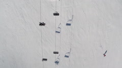 Directly above shot of ski lift passing over snow covered mountain Stock Footage