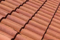 brown tile roof weathered on building residential - stock photo