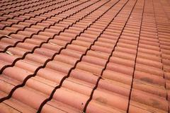 Brown tile roof weathered on building residential Stock Photos