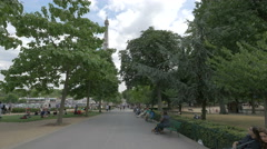Relaxing at Trocadero Gardens, near Eiffel Tower, in Paris Stock Footage
