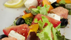 Salmon salad with feta cheese (loop) - stock footage