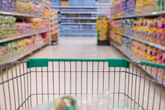 Closeup of trolley for shopping at supermarket Stock Photos