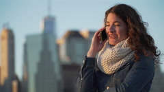 A beautiful woman talks on the phone Stock Footage