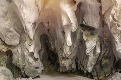 cave in the mountain, with stalagmites and stalactites - stock photo